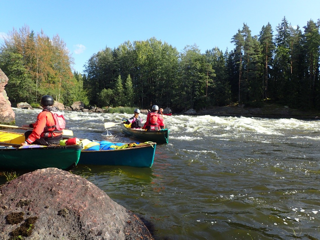 Students canoeing in rapids.