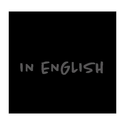 "puhekupla, jossa teksti ""in english""."