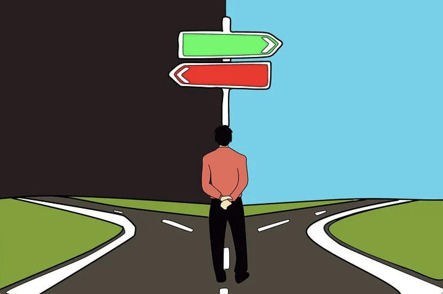 Piirroskuva, jossa selin oleva henkilö tuijottaa tienristeystä, jossa punainen kyltti vasemmalle ja vihreä oikealle.